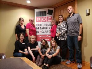 A group of professional organizers and volunteers doing a group organizing project
